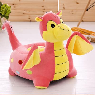 fotoliu din plus dragon de calarit roz